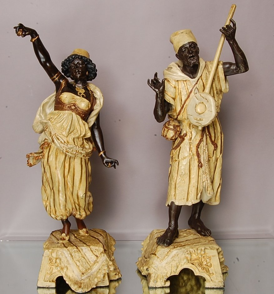 Pair of Blackmore style figures