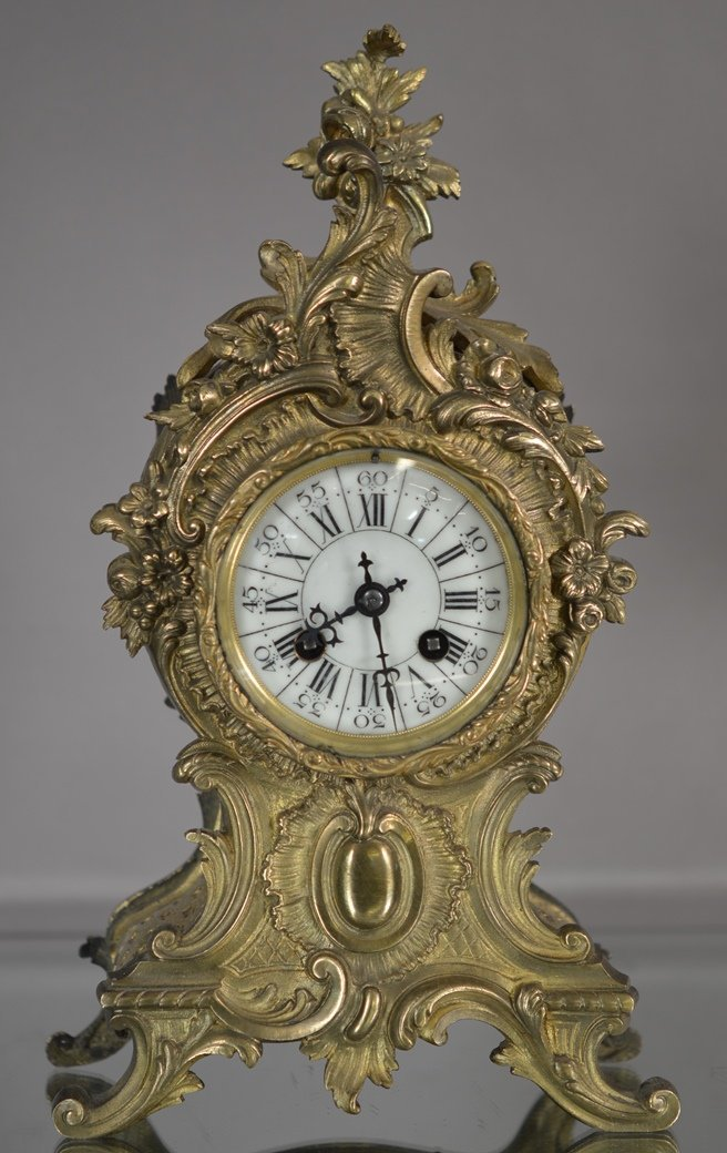French Louis XV style bronze mantel clock