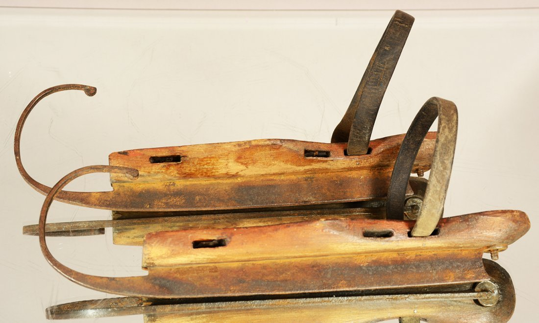 Pair of early wood & iron ice skates