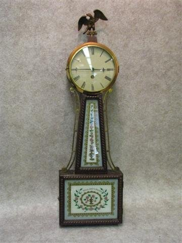 1005: Clock, Banjo Type, Reverse Painted Glass Marked '