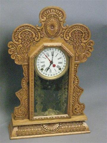 1006: Clock, Gingerbread Type, Pressed Oak, 8 Day Time