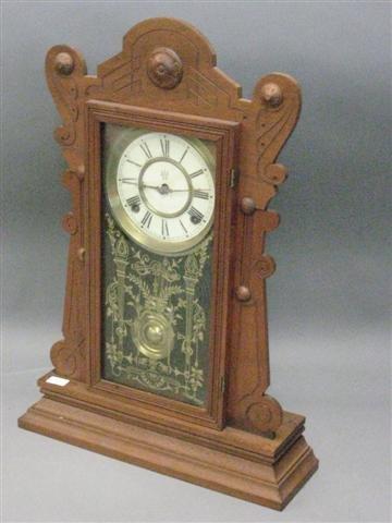 1016: Clock, Mantel Type, Walnut, by Waterbury Clock Co
