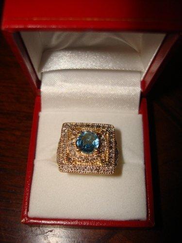 276: Ladies 10K Yellow Gold Diamond & Blue Topaz Ring