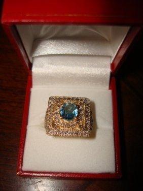 101: Ladies Ring 10K Yellow Gold Diamond & Blue Topaz