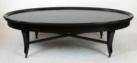 Oversize black oval coffee table on casters