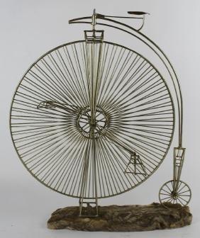 Vintage high wheel bicycle sculpture