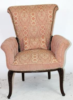 Antique arm chair with flared arms
