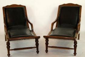Pair of mahogany and leather chaise longue