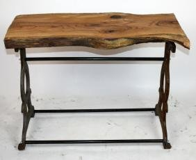 Industrial iron base table with naturalistic top