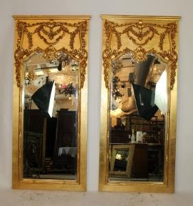 Pair of gold trumeau beveled mirrors