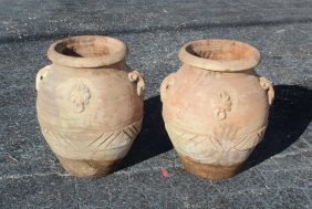 Pair of terra cotta olive oil jug style planters