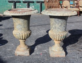 Pair of cast iron classical urns