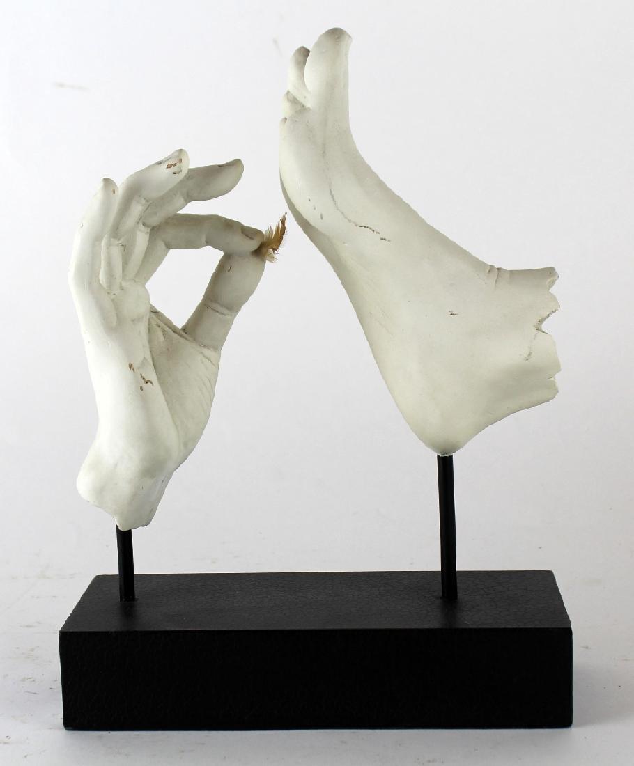 Sculpture of hand tickling foot