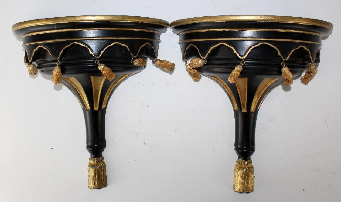 Pair of black and gold painted wall brackets