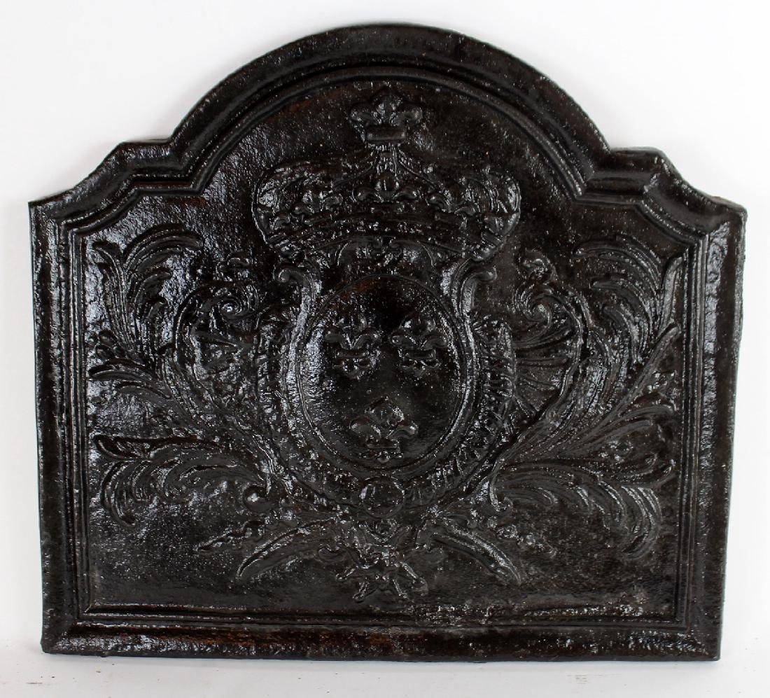 Antique French cast iron fireback with crown