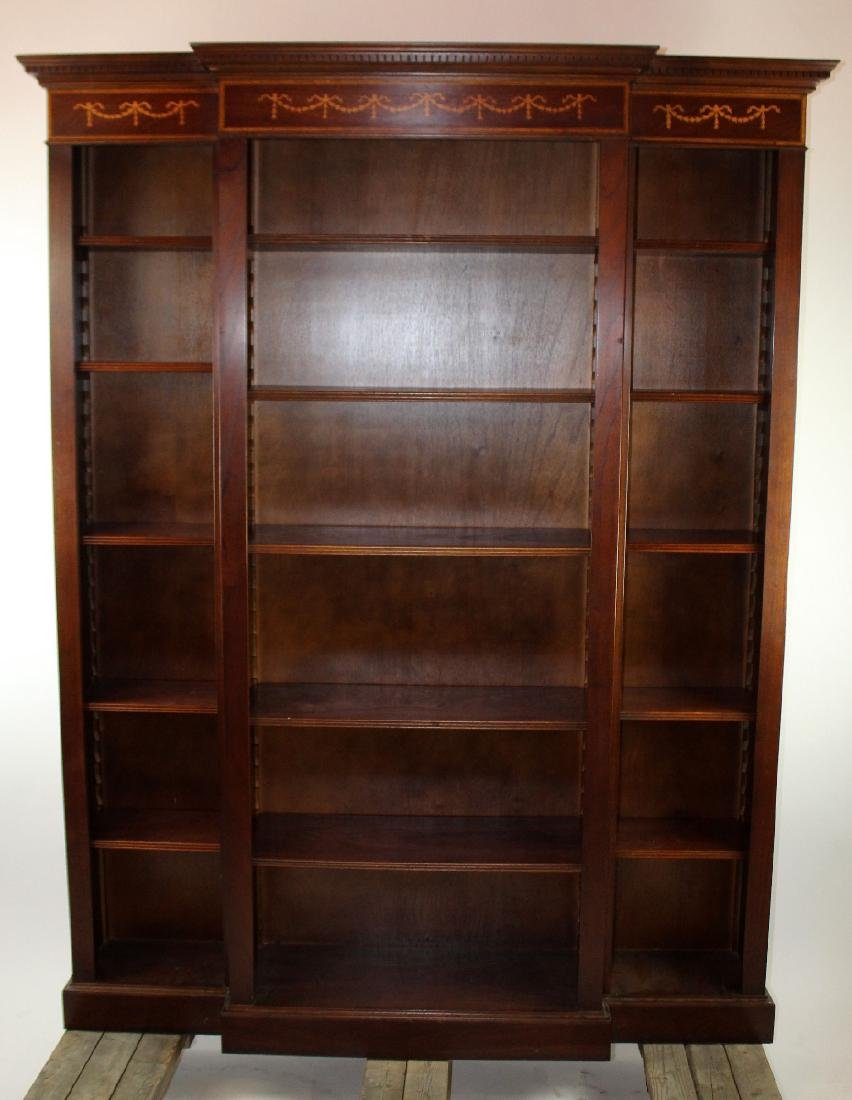 Mahogany open bookcase with ribbon detail