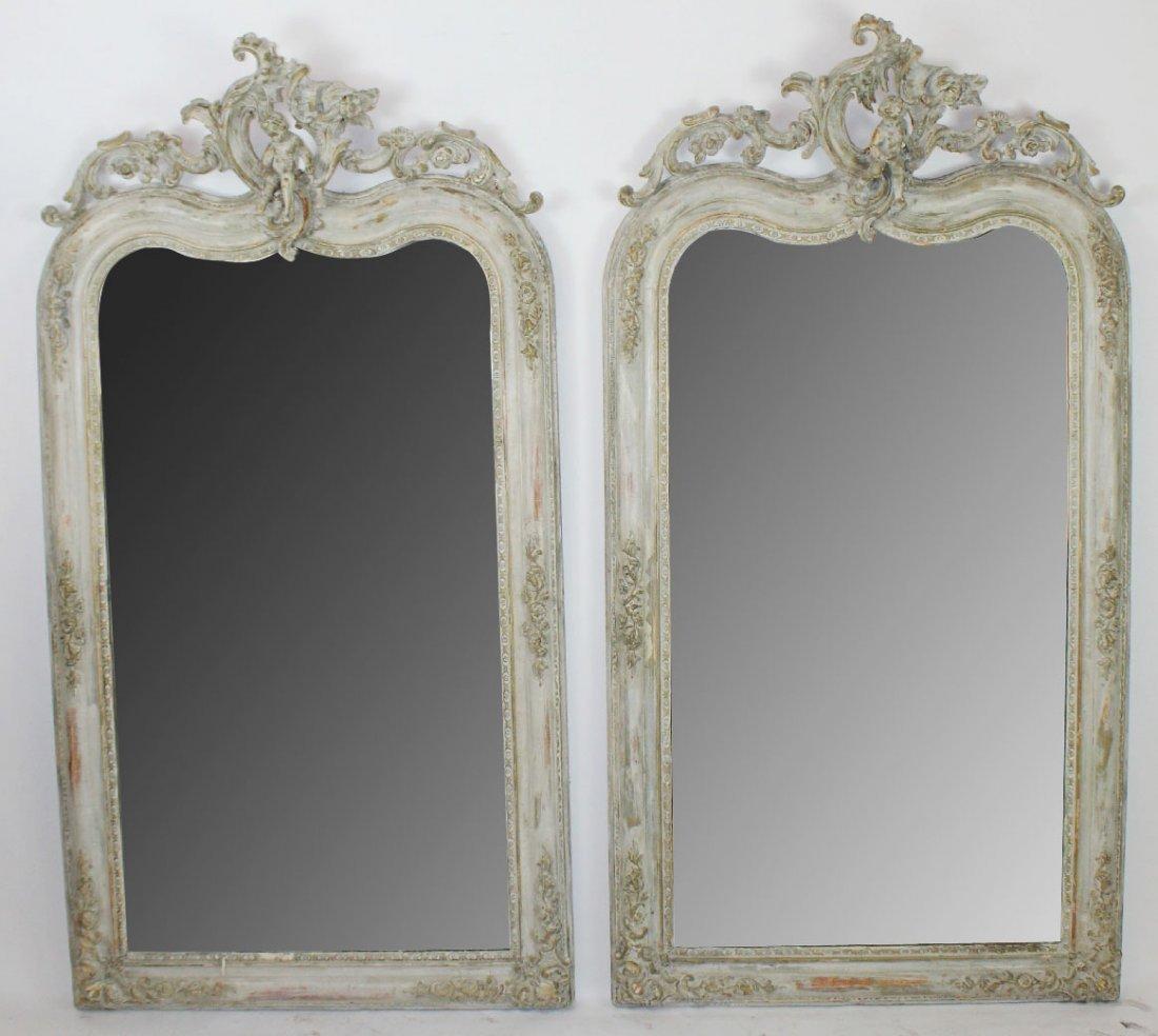 Pair of French Louis XVI mirrors with cherubs
