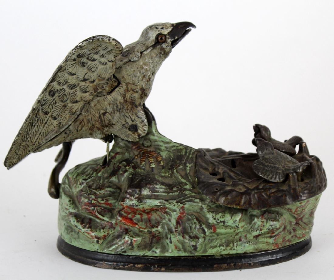 Mechanical coin op bank with birds