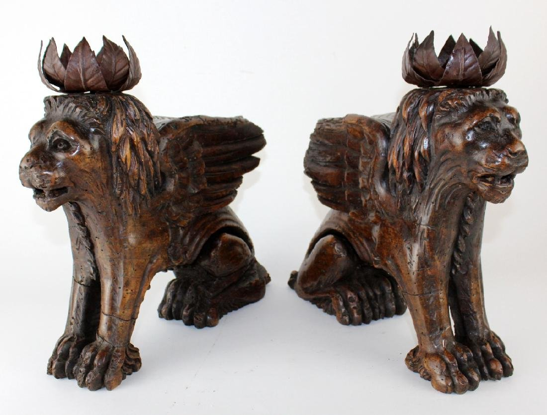 Pair of antique carved San Marco lions