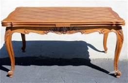 French Louis XV style oak drawleaf parquet table