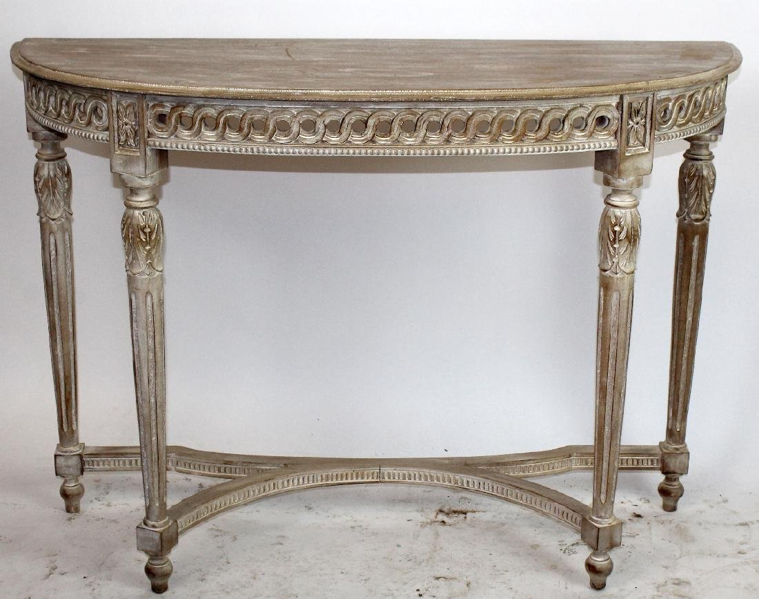 Carved and white washed demi-lune console