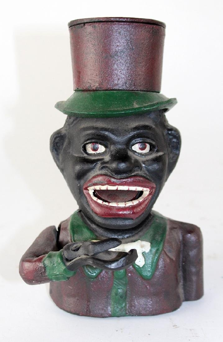 """Painted cast iron """"Jolly Negro"""" bank"""