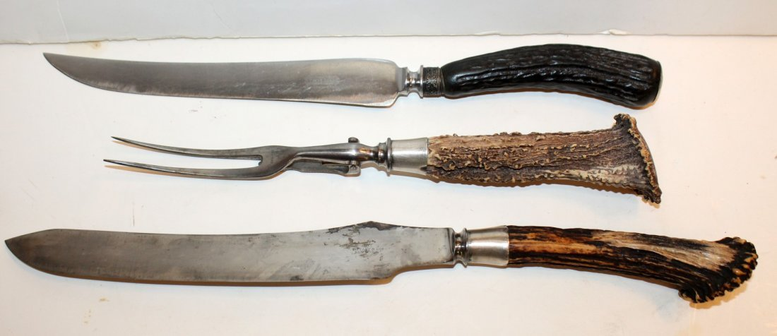 Stainless steel carving set with antler handles
