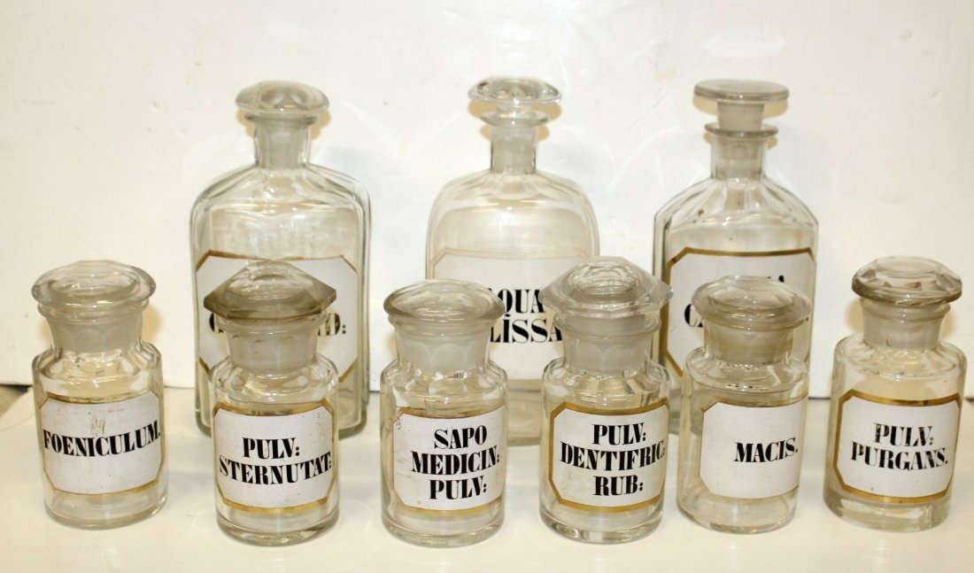 Lot of 9 glass apothecary bottles