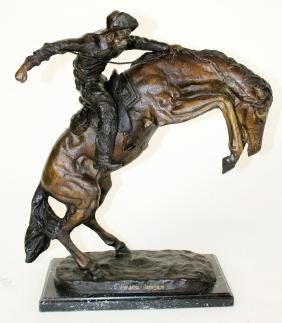 """Bronze statue """"Wooly Chaps"""" after Frederic Remington."""