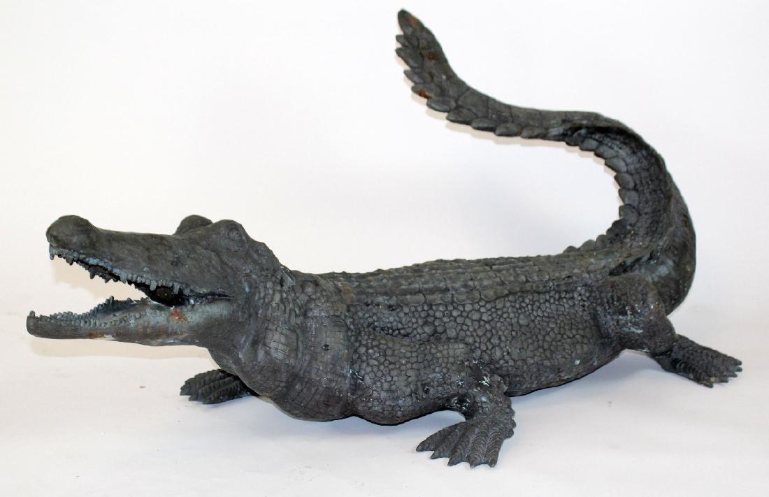 Verdigris bronze alligator statue.
