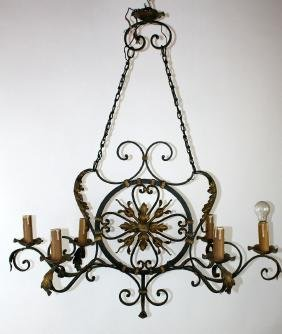 French wrought iron chandelier with gilt accents.