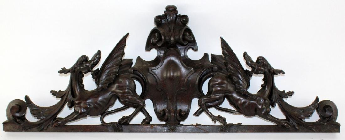 French carved walnut over door with gryphons