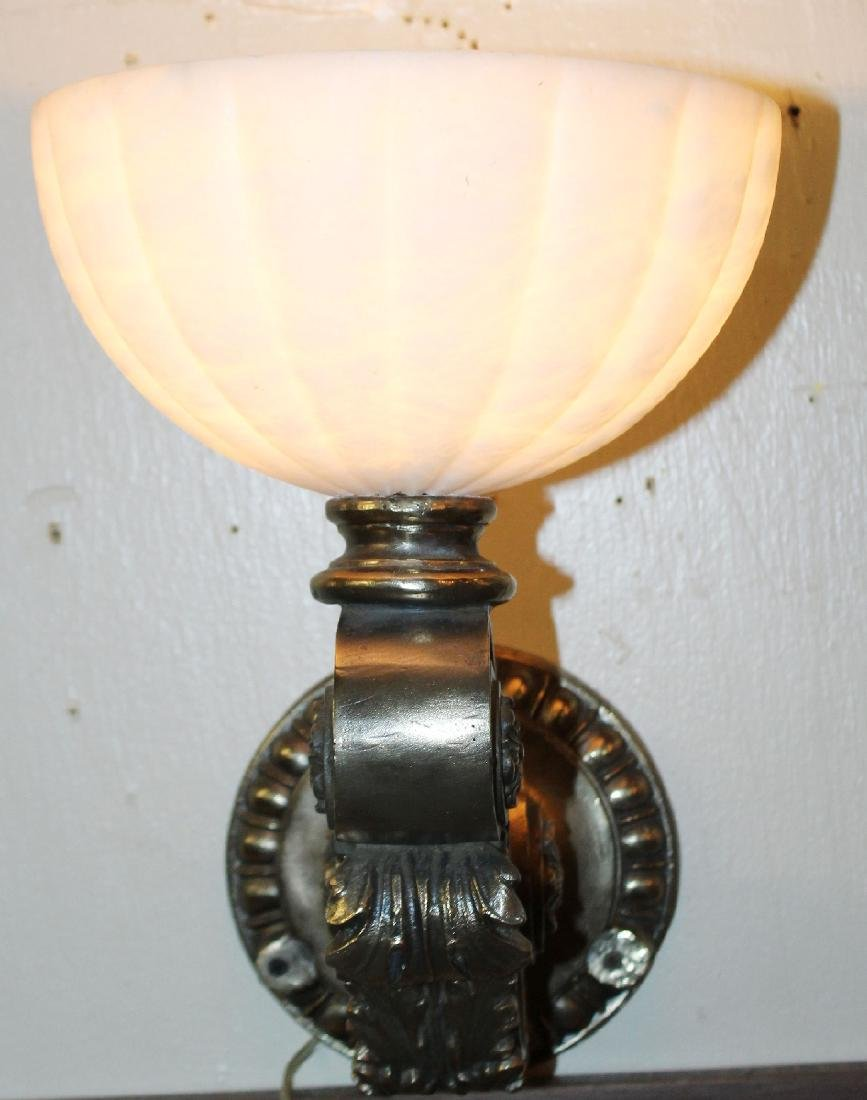 Polished bronze sconce with alabaster shade