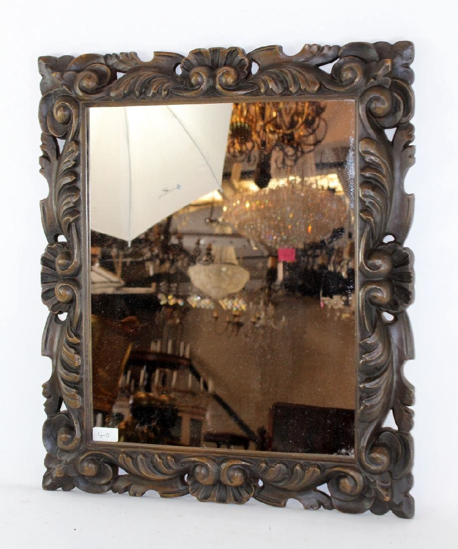 Carved English framed mirror