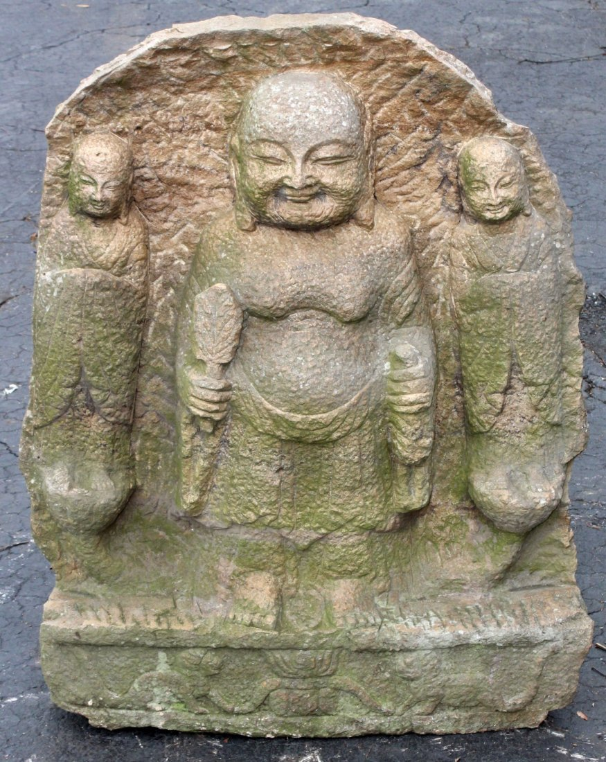 Carved stone temple panel with Buddha