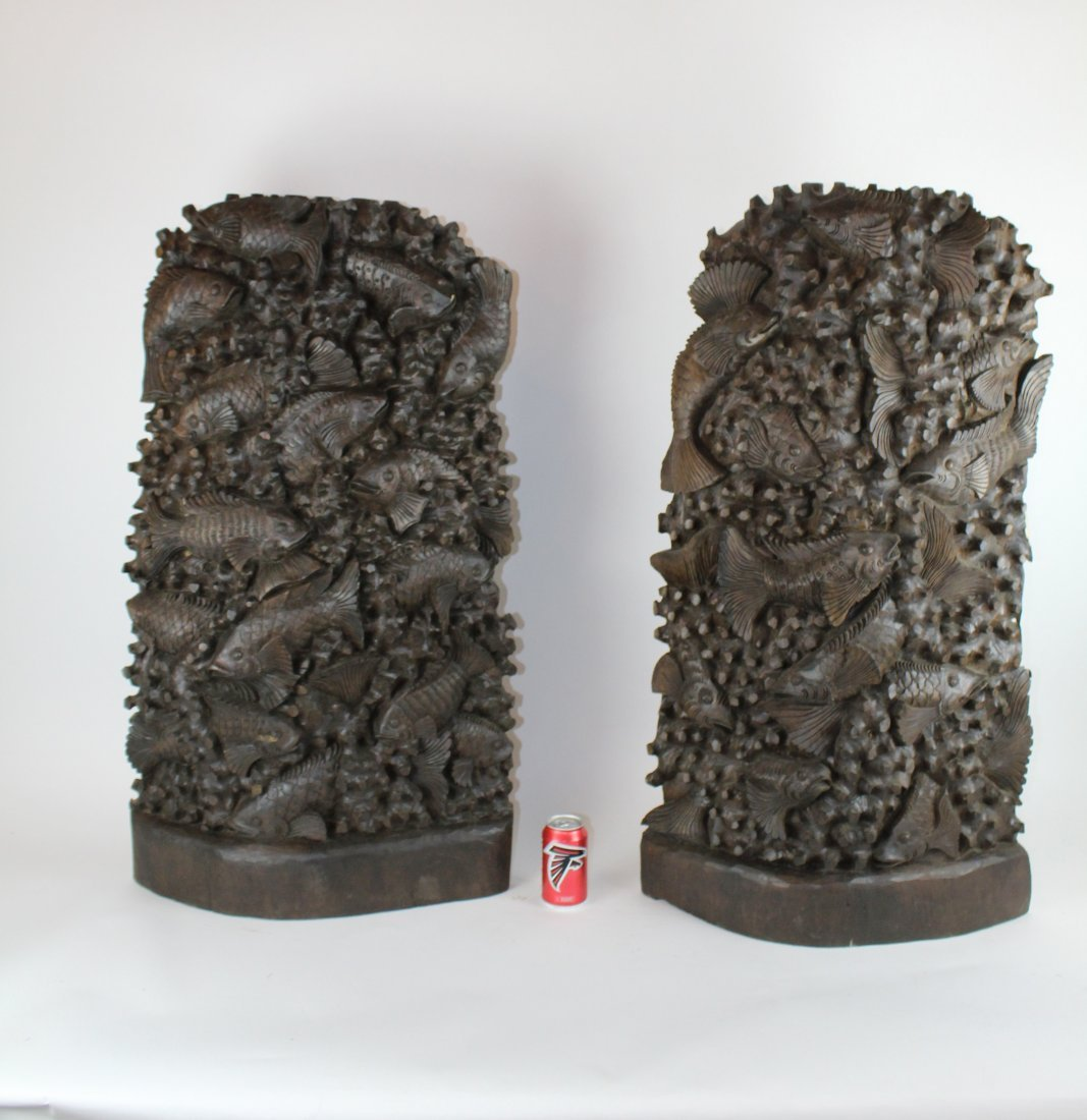Pair of carved Chinese hardwood panels with fish