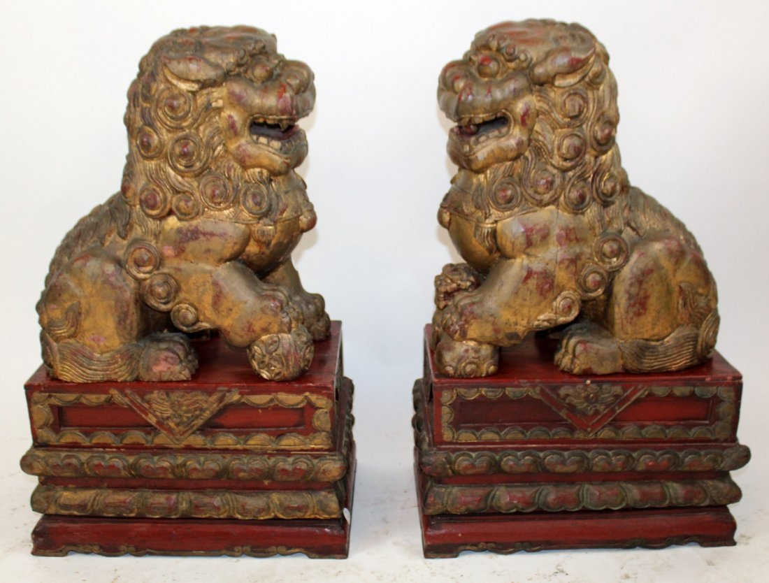 Pair of Chinese carved wooden foo lions