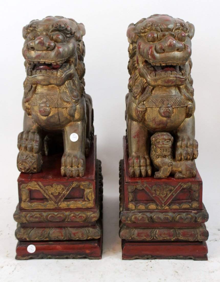 Pair of Chinese carved wooden foo lions - 2