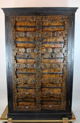 Large scale armoire with temple carved panel doors