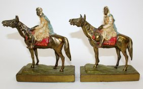 Pair of polychrome Arabian man on horse bookends