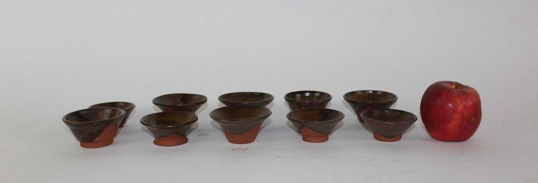 Lot of 10 Chinese glazed terra cotta conical tea bowls