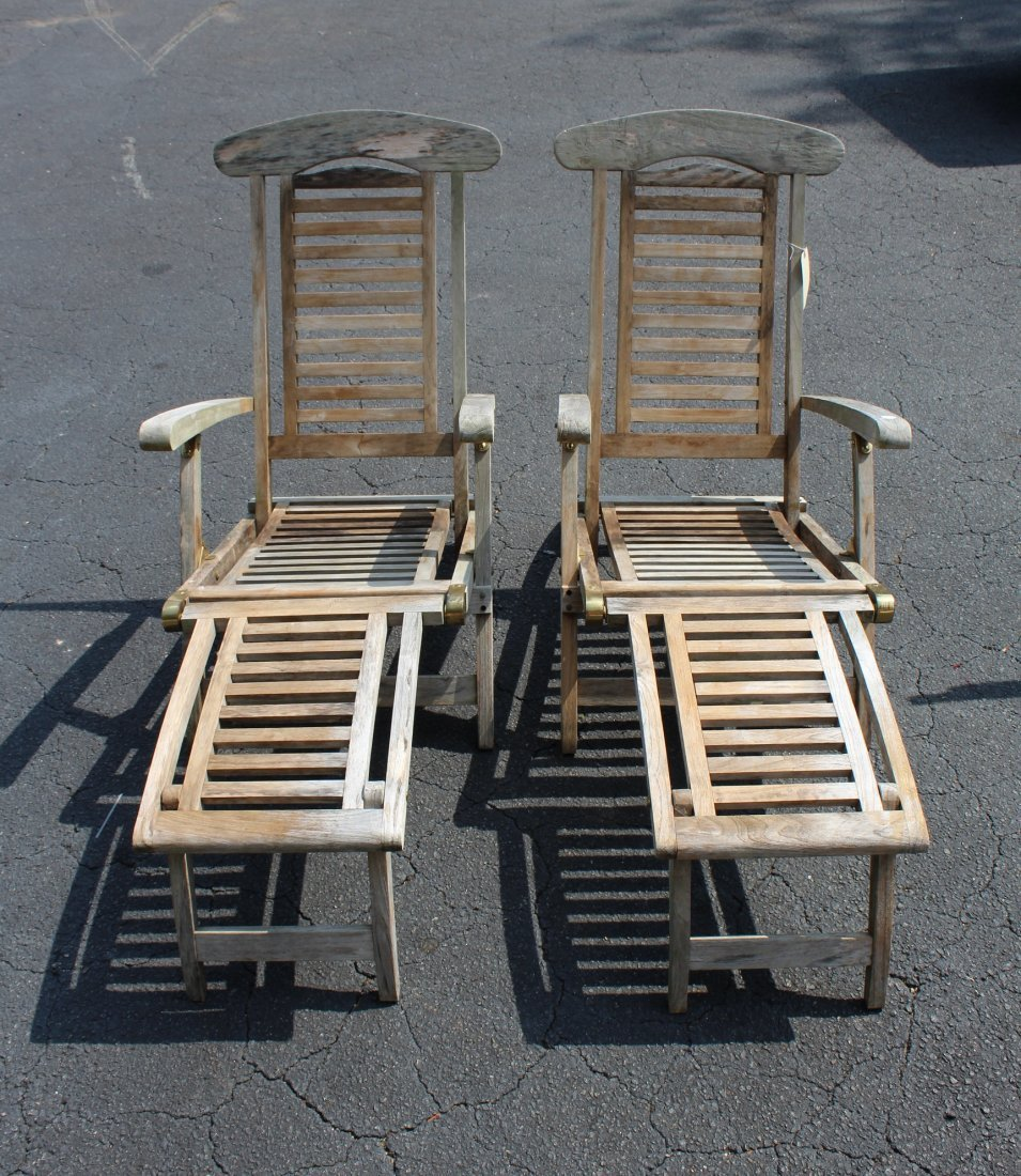 Pair of teak steamer lounge chairs