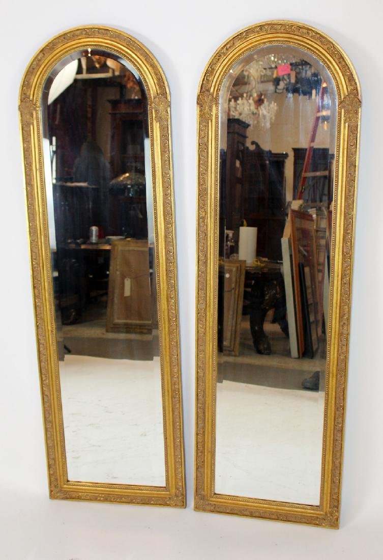Pair of gold arch top mirrors