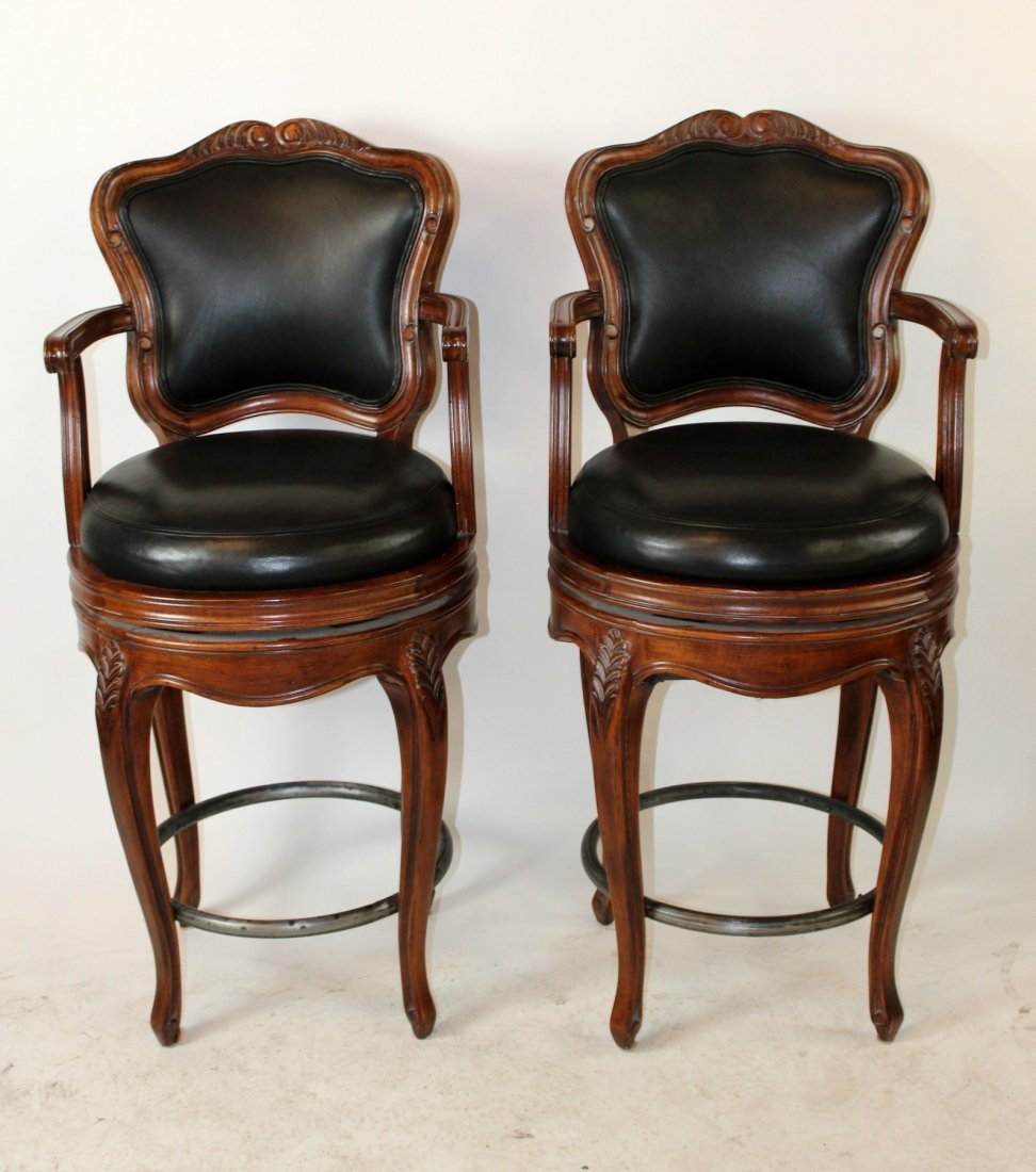 Pair of mahogany and black leather barstools