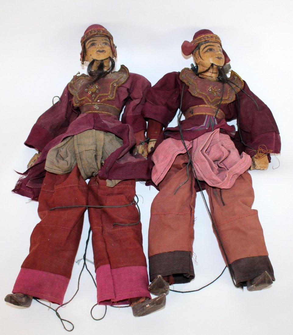 2 antique Tibetan puppets