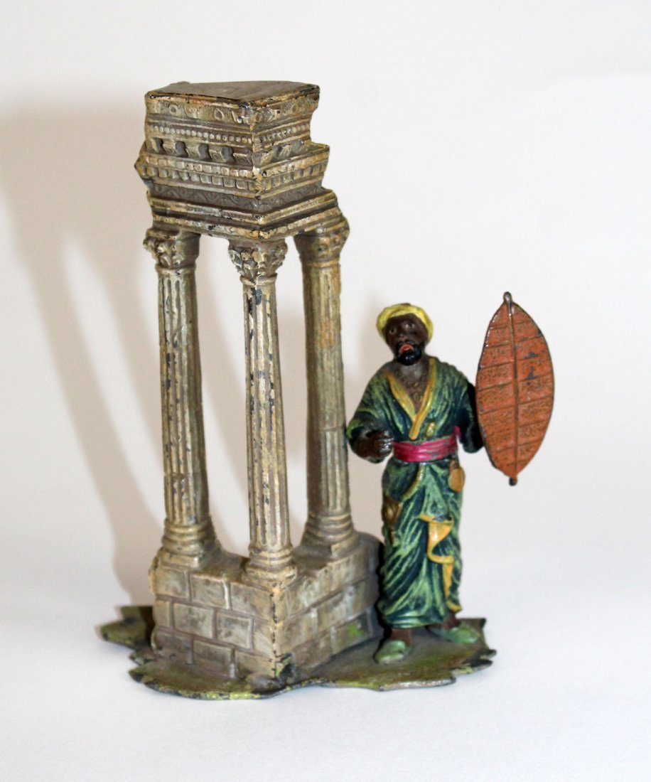 Polychrome bronze figurine with ruins
