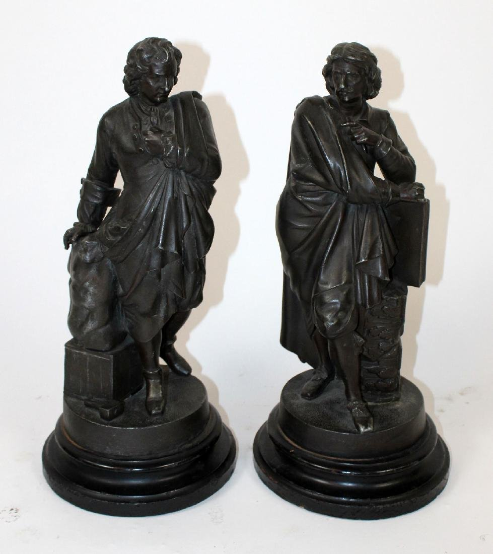 Pair of figural statues in spelter