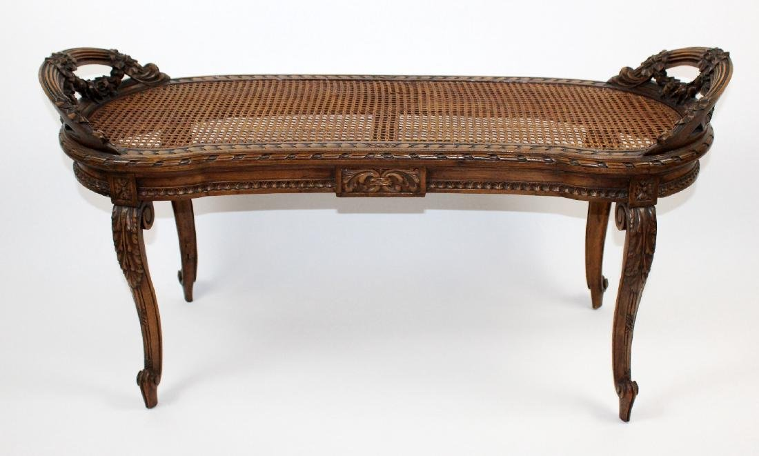 Louis XVI style caned bench in walnut