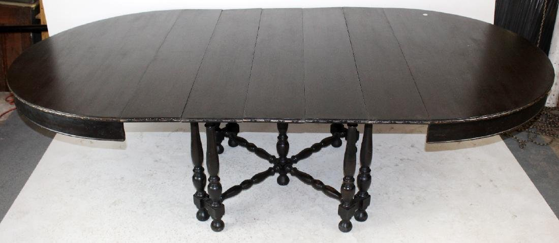 Spindle leg ebonized dining table - 2