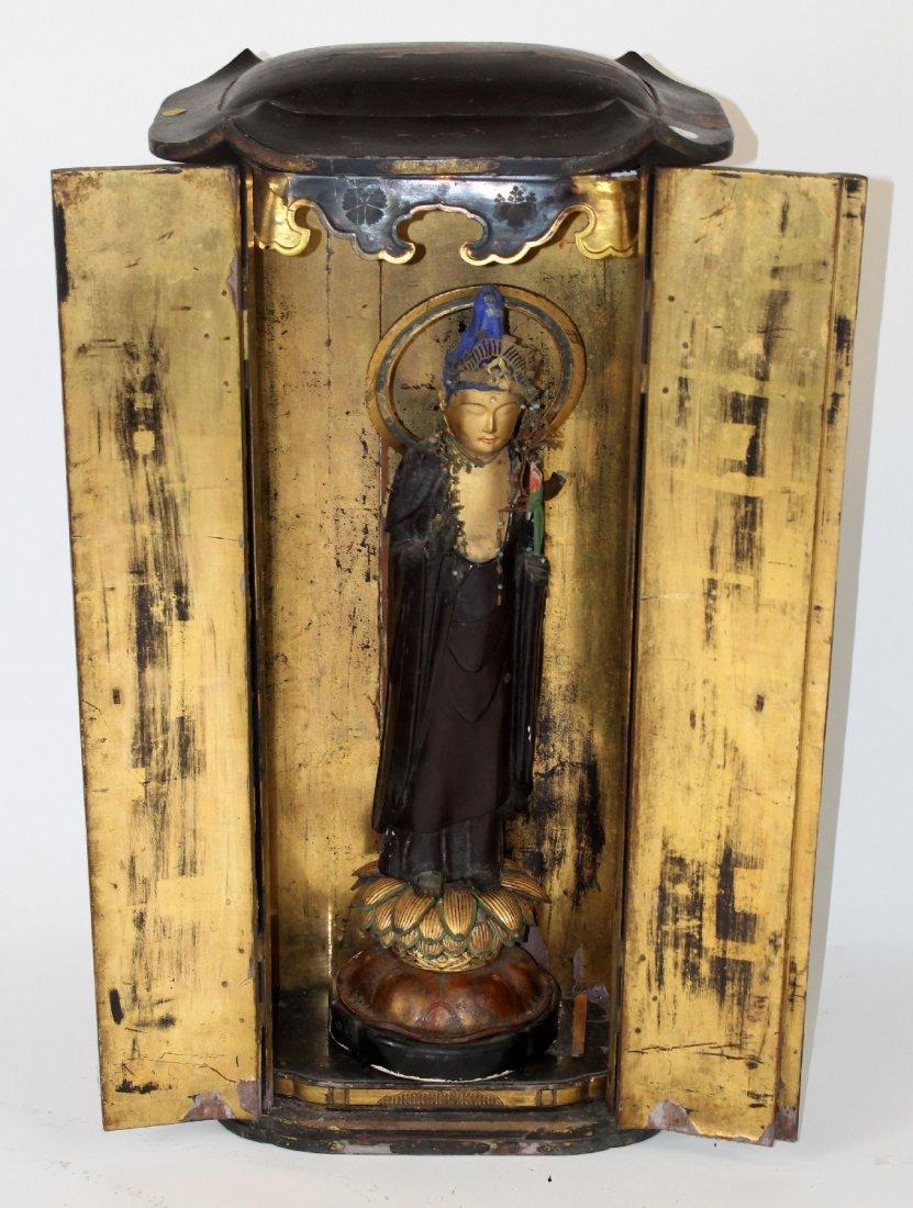 Buddhist icon in cabinet